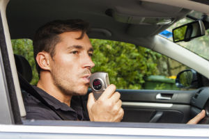 Man Taking A Breathalyzer Test